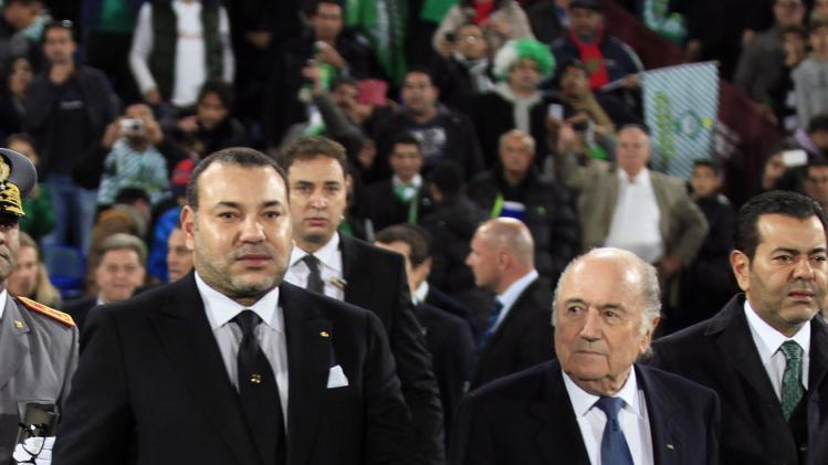 Morocco's King Mohammed VI arrives with FIFA President Blatter to watch the 2013 FIFA Club World Cup final soccer match between Morocco's Raja Casablanca and Germany's Bayern Munich at Marrakech stadium