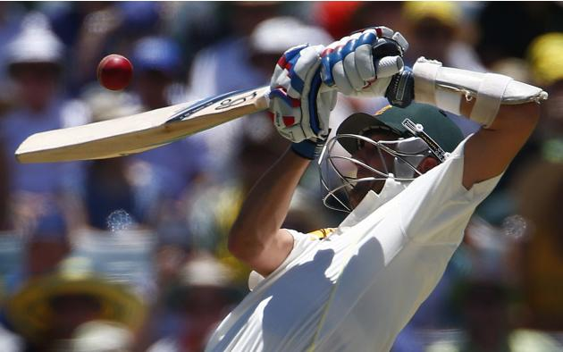 Australia's Lyon tries to play a shot for a bouncer during the second day of the third Ashes test cricket match against England in Perth