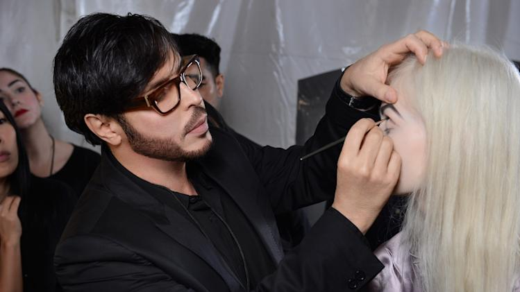 This Sept. 10, 2012 photo shows make-up artist Francois Nars, preparing a model for the Marc Jacobs Spring 2013 collection during Fashion Week in New York. Nars' company has taken on Andy Warhol's silvery Factory, silkscreened superstars and avant-garde films in a limited-edition cosmetic collection, exclusive to Sephora stores until Nov. 1. (AP Photo/Nars Cosmetics)