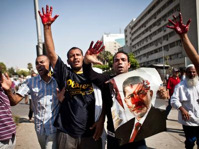 Pro, Anti-Morsi Egyptians Lock in Deadly Clashes