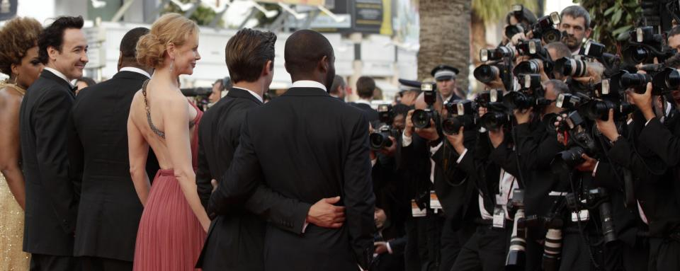 Cast members from left, Macy Gray, John Cusack, director Lee Daniels, Zac Efron, and David Oyelowo arrive for the screening of The Paperboy at the 65th international film festival, in Cannes, southern France, Thursday, May 24, 2012. (AP Photo/Virginia Mayo)