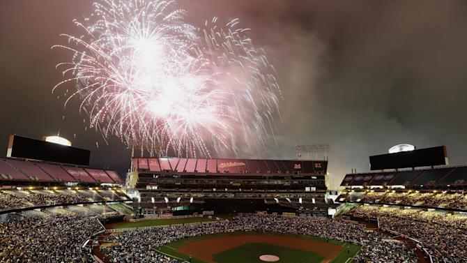 Fans at O.co Coliseum watch a fireworks show after a baseball game between the Oakland Athletics and the Seattle Mariners in Oakland, Calif., Friday, July 3, 2015. The Mariners won 9-5. (AP Photo/Jeff Chiu)