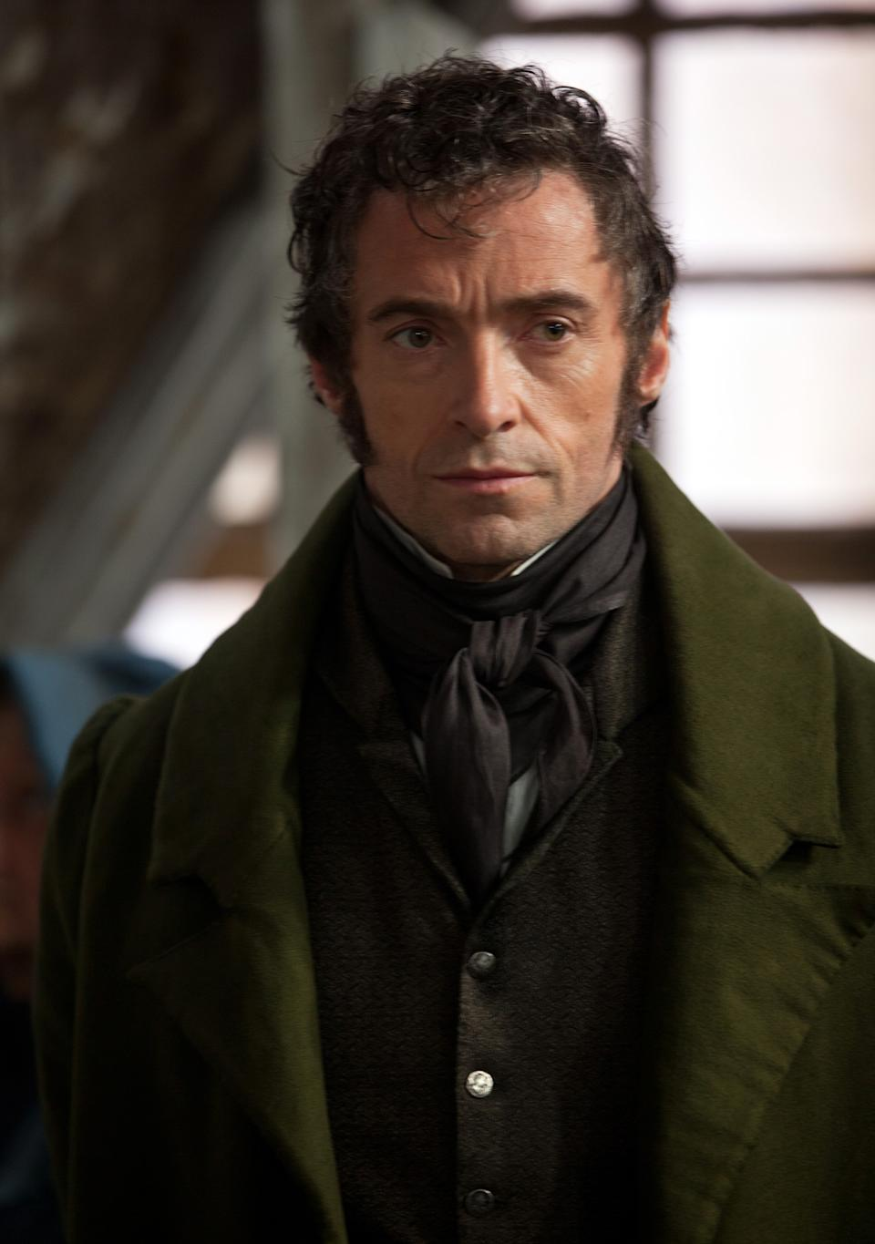 "FILE - This publicity file image released by Universal Pictures shows Hugh Jackman as Jean Valjean in a scene from ""Les Miserables.""  The costumes for the film were designed by Spanish designer Paco Delgado. (AP Photo/Universal Pictures, Laurie Sparham, File)"