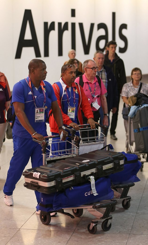 LONDON, ENGLAND - JULY 16: Members of the Cuban Olympic team arrive at Heathrow Airport on July 16, 2012 in London, England. Athletes, coaches and Olympic officials are beginning to arrive in London a