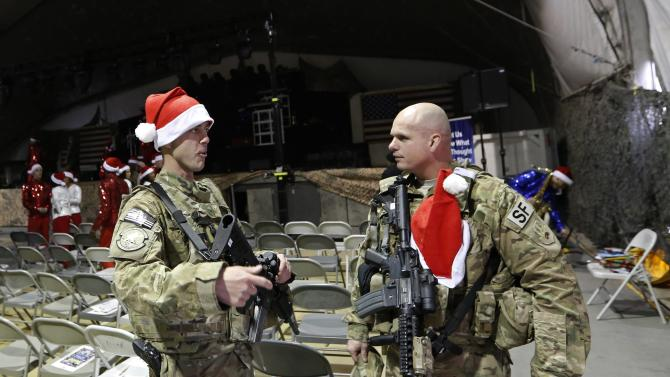 U.S. troops from the Nato-led International Security Assistance Force attend a Christmas day concert for U.S. military personnel at Bagram Airfield, north of Kabul