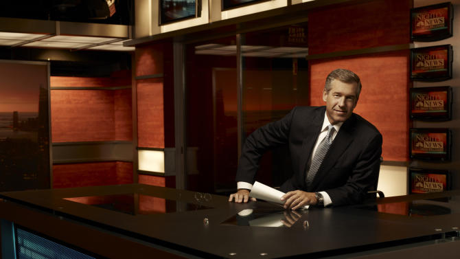 "This 2009 photo released by NBC shows Brian Williams on the set of ""Nightly News with Brian Williams,"" in New York. ABC, CBS, NBC evening newscasts had 11 percent fewer viewers because of the time change and longer days. The Nielsen company says the newscasts collectively had 11 percent fewer viewers last week than they did the week before. (AP Photo/NBC News, Justin Stephens)"