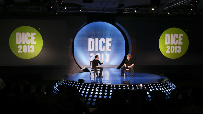"""CORRECTION TO CLARIFY ABRAMS' COMMENTS ABOUT THE NEXT STAR WARS FILM -  Producer and director J.J. Abrams, left, talks with Valve president and co-founder Gabe Newell during a keynote discussion at the D.I.C.E. Summit, Wednesday, Feb. 6, 2013, in Las Vegas. A newly announced """"Star Wars"""" sequel was on everyone's mind when Abrams took the stage at the annual video game conference, but he made only a sideways mention of the film he has been hired to direct.  (AP Photo/Julie Jacobson)"""