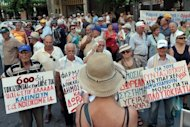 Greek pensioners march towards the Health Ministry in Athens last month to protests against austerity. The European Central Bank has moved to stave off the bankrupcty of Greece by guaranteeing loans from the country's central bank, a German newspaper has reported