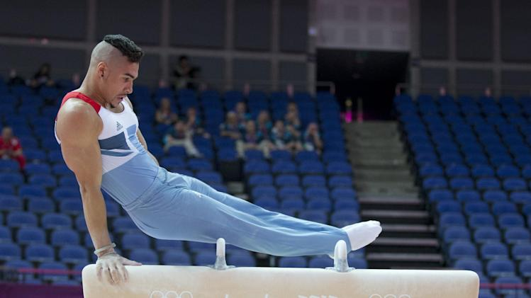 Britain's Louis Smith performs on the pommel horse during a training session ahead of the 2012 Summer Olympics, Wednesday, July 25, 2012, in London.  (AP Photo/Julie Jacobson)