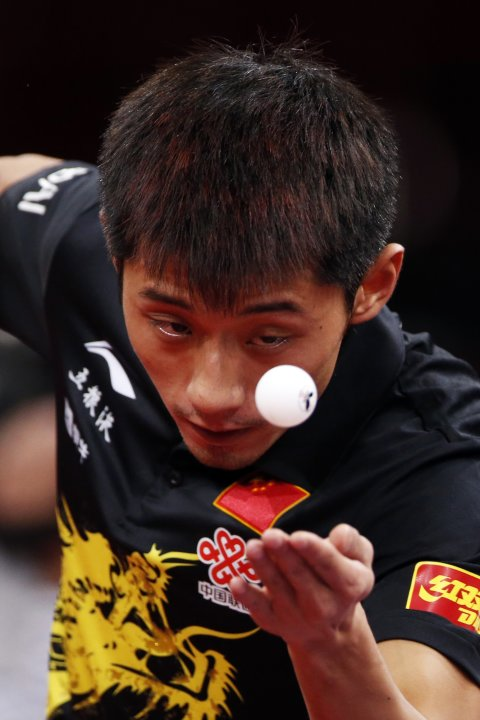 China's Zhang Jike serves during his men's singles final at the World Team Table Tennis Championships in Paris