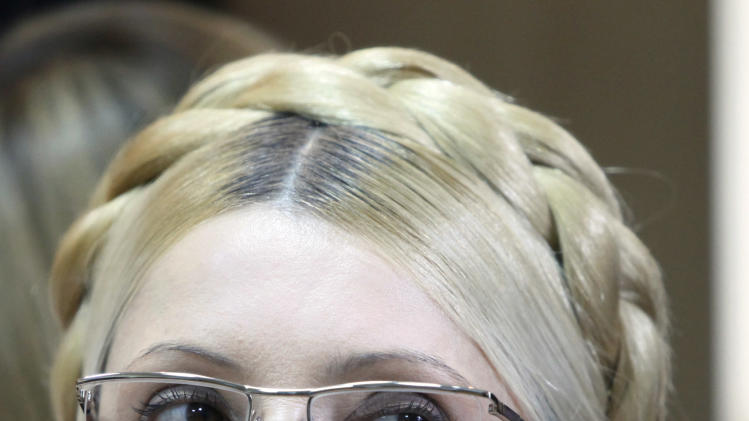 FILE - In this file photo taken on Tuesday, Oct. 11, 2011, former Ukrainian Prime Minister Yulia Tymoshenko is seen during her trial, at Court in Kiev, Ukraine.  Tymoshenko is suffering from a severe spinal condition and needs urgent treatment, but she refused treatment at a local clinic in Kharkiv, Ukraine, and has launched a hunger strike in protest against alleged violence by prison guards. Ukraine's President Viktor Yanukovych on Thursday April 26, 2012, ordered a thorough probe into the alleged beating of Tymoshenko who is currently serving a seven-year prison term on charges of abusing her powers during negotiations about gas supplies with Russia. (AP Photo/Tymoshenko Press Service, FILE)