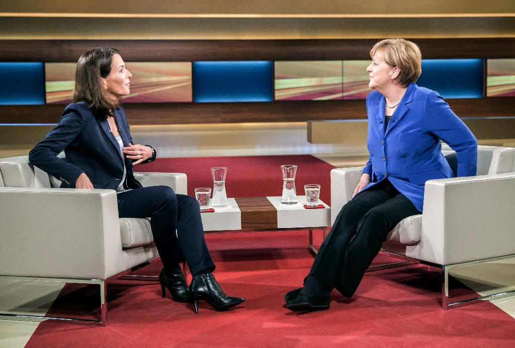Under fire in refugee crisis, Merkel goes on offensive