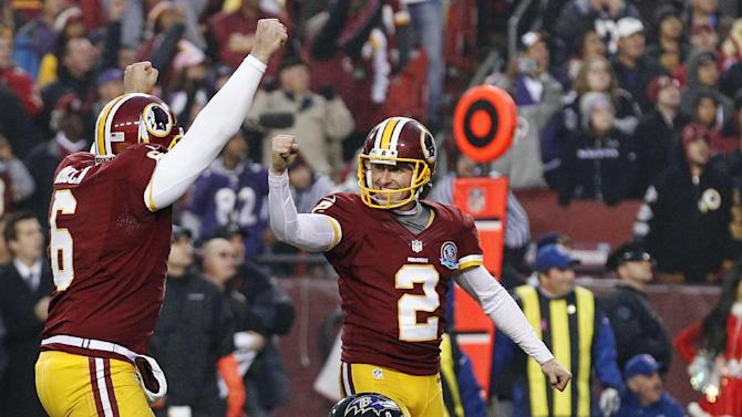 Washington Redskins kicker Kai Forbath celebrates the winning field goal with Sav Rocca during overtime of an NFL football game against the Baltimore Ravens in Landover, Md., Sunday, Dec. 9, 2012. The Redskins won 31-28. (AP Photo/Alex Brandon)