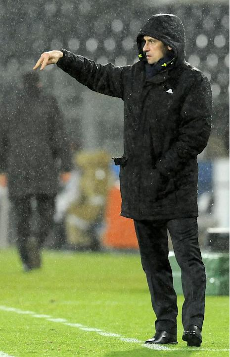 Olympique Lyonnais' coach Remi Garde gives instructions on the sideline, during their 2-1 victory over Victoria Guimaraes, in a Europa League Group I soccer match at the D. Afonso Henriques Stadiu