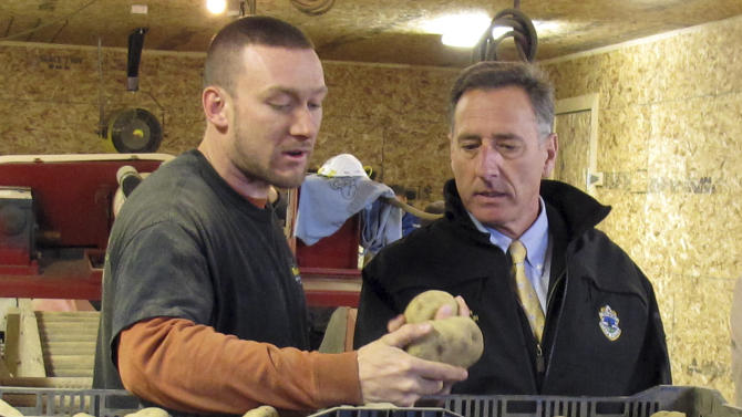 Vermont prison inmate Matthew Mabe, left, shows Gov. Peter Shumlin how potatoes are processed at the Southeast State Correctional Facility in Windsor, Vt., on Monday, Nov. 19, 2012. The inmates are working as part of a program that is providing potatoes to Vermont food shelves in time for Thanksgiving. (AP Photo/Wilson Ring)