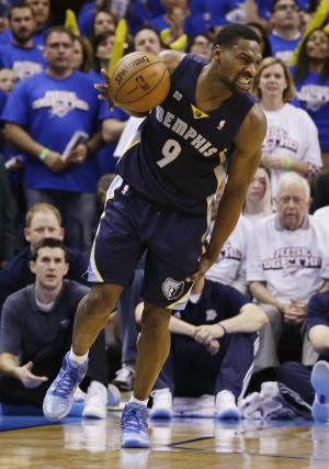 Memphis Grizzlies shooting guard Tony Allen (9) grabs his leg after collecting his own rebound late in the second half  against the Oklahoma City Thunder at Game 2 of their Western Conference semifinal NBA basketball playoff series Tuesday, May 7, 2013, in Oklahoma City. The Grizzlies won 99-93. (AP Photo/Tony Gutierrez)