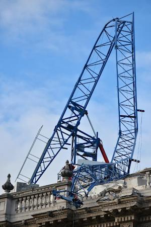 A construction crane lays on top of the cabinet office…