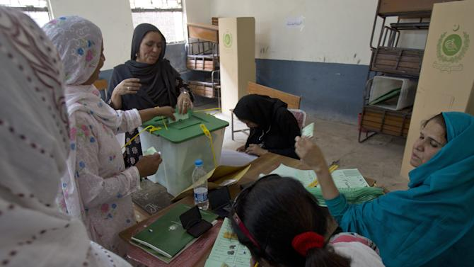 Pakistani women cast their ballots at a polling station in Islamabad, Pakistan on Saturday, May 11, 2013. Despite a bloody campaign marred by Taliban attacks, Pakistan was holding historic elections Saturday pitting a former cricket star against a two-time prime minister once exiled by the army and an incumbent blamed for power blackouts and inflation. (AP Photo/B.K. Bangash)