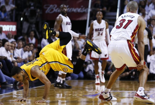 Indiana Pacers' Augustin falls next to Miami Heat's Battier during their NBA Eastern Conference final basketball playoff in Miami