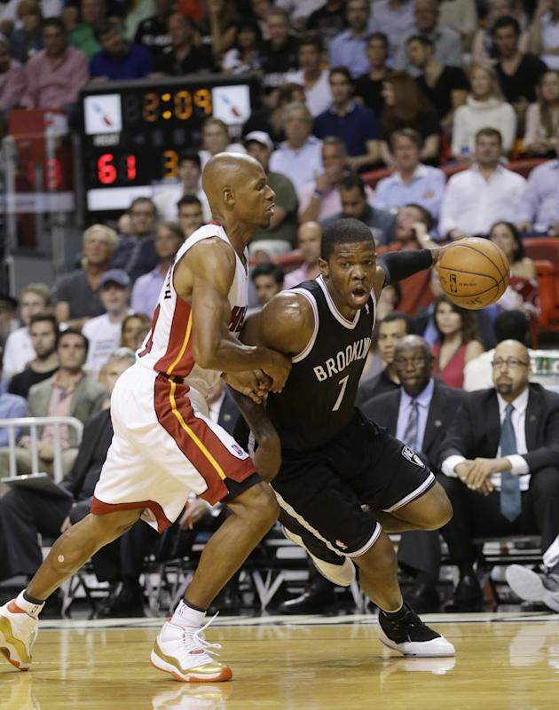 Brooklyn Nets guard Joe Johnson drives past Miami Heat guard Ray Allen during the second half of an NBA basketball game, Tuesday, April 8, 2014 in Miami. The Nets defeated the Heat 88-87. (AP Photo/Wilfredo Lee)