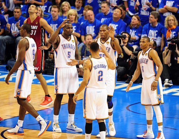 Oklahoma City Thunder's Kendrick Perkins (5), Thabo Sefolosha (2), Kevin Durant (35) And Russell Westbrook (0) AFP/Getty Images
