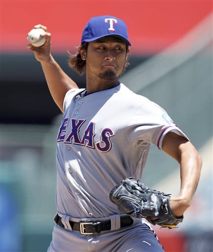 Rangers batter Santana, even series with Angels