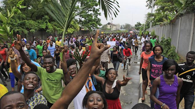 "Students of university of Lagos protest following the renaming of the University by Nigerian President Goodluck Jonathan in Lagos, Nigeria, Tuesday, May 29. 2012. Nigeria has renamed a major university in the commercial capital of Lagos after a political prisoner who died in jail over a decade ago. President Goodluck Jonathan announced Tuesday on state-run television that the University of Lagos would be renamed Moshood Abiola University in honor of the presidential hopeful's ""martyrdom.""  (AP Photo/Sunday Alamba)"
