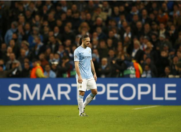 Manchester City's Martin Demichelis walks off after being shown the red card during their Champions League round of 16 first leg soccer match against Barcelona at the Etihad Stadium in Manchester