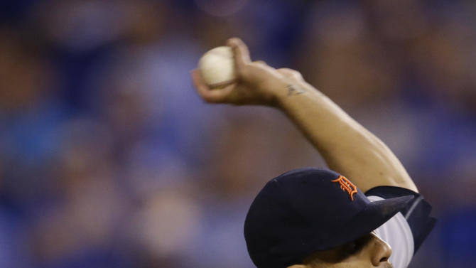 Detroit Tigers starting pitcher David Price delivers to a Kansas City Royals batter during the ninth inning of a baseball game at Kauffman Stadium in Kansas City, Mo., Saturday, May 2, 2015. (AP Photo/Orlin Wagner)