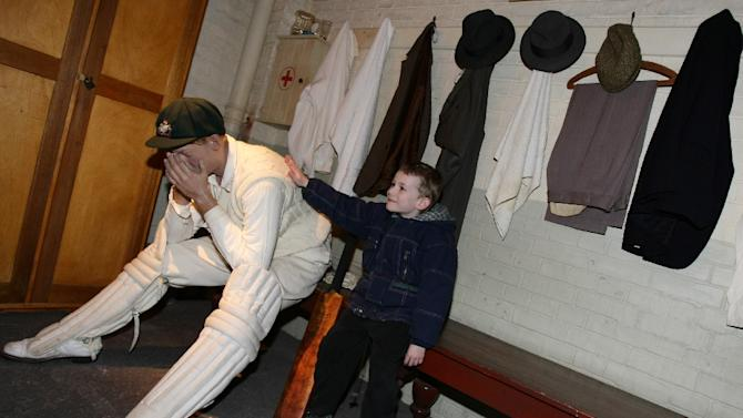 File picture shows a young visitor giving a pat on the back to a lifesize model of Australian cricket legend Donald Bradman at the Bradman Museum in the cricketer's boyhood hometown of Bowral south of Sydney