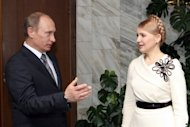 Russian Prime Minister Vladimir Putin welcomes his Ukrainian counterpart Yulia Tymoshenko before a 2009 meeting in Moscow. Putin has said his country is willing to accept Tymoshenko for medical treatment, amid growing EU anger over her case