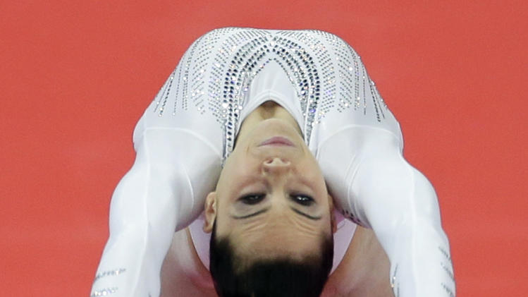 U.S. gymnast McKayla Maroney performs during the artistic gymnastics women's vault  final at the 2012 Summer Olympics, Sunday, Aug. 5, 2012, in London. (AP Photo/Gregory Bull)