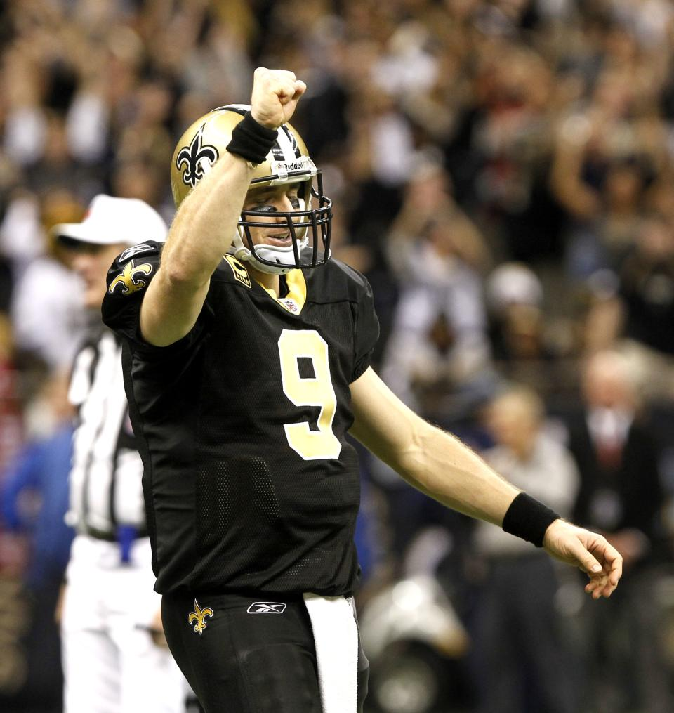 New Orleans Saints quarterback Drew Brees (9) celebrates after breaking Dan Marino's all time season passing record in the fourth quarter of an NFL football game against the Atlanta Falcons in New Orleans, Monday, Dec. 26, 2011. (AP Photo/Rusty Costanza)