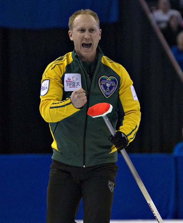 Northern Ontario skip Jacobs reacts after his shot during the Canadian Men's Curling Championships in Edmonton