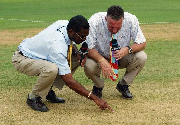KINGSTON, JAMAICA - MARCH 13:  Sky Sports commentators Ian Botham (R) and Michael Holding inspect the pitch before the start of play during the Cable and Wireless First Test match between West Indies 