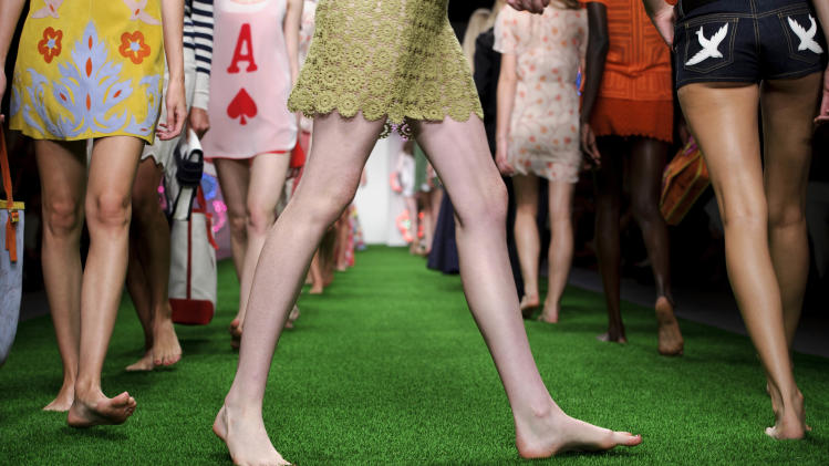 Models wear designs from the Jasper Conran Spring/Summer 2013 collection during London Fashion Week, Saturday, Sept. 15, 2012. (AP Photo/Jonathan Short)