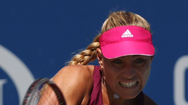 Angelique Kerber, of Germany, returns a shot against Belinda Bencic, of Switzerland, during the third round of the 2014 U.S. Open tennis tournament, Friday, Aug. 29, 2014, in New York. (AP Photo/John Minchillo)