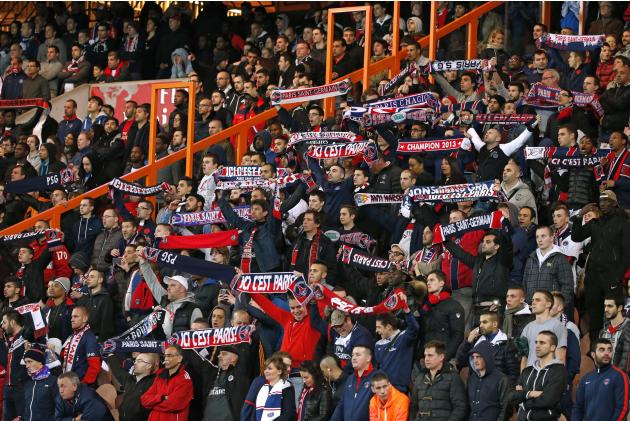 Paris Saint-Germain's supporters cheer their team during their French Ligue 1 soccer match against St Etienne at the Parc des Princes Stadium in Paris