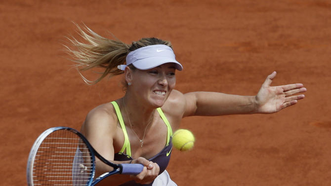 Russia's Maria Sharapova returns the ball to Serena Williams, of the U.S, during the Women's final match of the French Open tennis tournament at the Roland Garros stadium Saturday, June 8, 2013 in Paris.  (AP Photo/Christophe Ena)