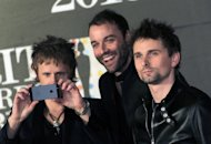 From left, Dominic Howard, Christopher Wolstenholme, and Matthew Bellamy of British band Muse seen arriving at the BRIT Awards 2013 at the o2 Arena in London on Wednesday, Feb. 20, 2013. (Photo by Joel Ryan/Invision/AP)