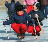 "This file photo shows local yougsters skating at Pyongyang's outdoor ice skating rink, on January 30, 1995. N.Korea is rewarding the scientists and workers behind its recent nuclear test with a fun-packed visit to Pyongyang to enjoy ""the greatest privileges,"" including a visit to the city's open-air ice rink and roller skating centre"