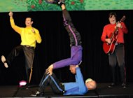 This file photo shows 'The Wiggles' (L to R) Sam Moran, Jeff Fatt (top), Anthony Field and Murray Cook performing in Sydney, in 2010. The Wiggles announced the end of an era on Thursday, with three of the quartet to retire from performing and a woman to don the turtleneck for the first time