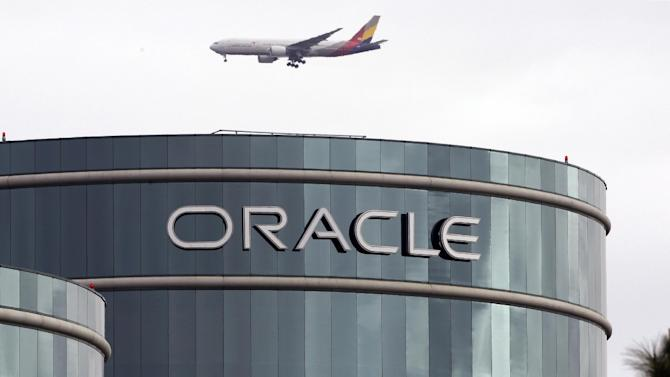 FILE - In this  Tuesday, March 20, 2012, file photo, a plane flies over Oracle headquarters in Redwood City, Calif. Oracle's latest quarterly earnings rose 18 percent as companies splurged on more software and other technology toward the end of the year.  (AP Photo/Paul Sakuma, File)