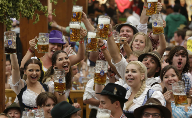 Young people enjoy the opening ceremony of the famous Bavarian &quot;Oktoberfest&quot; beer festival in Munich, southern Germany, Saturday, Sept. 22, 2012. The world&#39;s largest beer festival, to be held from Sept. 22 to Oct. 7, 2012 will see some million visitors. (AP Photo/Matthias Schrader)