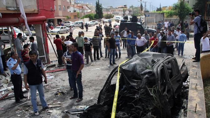 The site of one of explosions after several explosions killed at least 40 people and injured dozens in Reyhanli, near Turkey's border with Syria, Saturday, May 11, 2013, Turkish Interior Minister Muammer Guler said.(AP Photo/IHA) TURKEY OUT