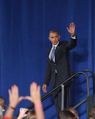 US President Barack Obama waves at a campaign fundraiser on October 11 at a hotel in Miami, Florida. The latest developments over security at the US consulate in Libya would be a headache at any time for the White House, but are especially nettlesome given Obama's looming date with voters on November 6