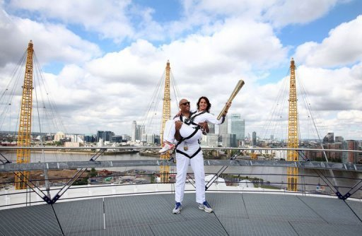&lt;p&gt;Olympic torch bearers John Amaechi and Nadia Comaneci pose for pictures on the viewing platform of the North Greenwich Arena in south London. Olympics legend Comaneci held the 2012 torch aloft over London as the flame began a seven-day tour of the host city that will culminate at the Games opening ceremony.&lt;/p&gt;
