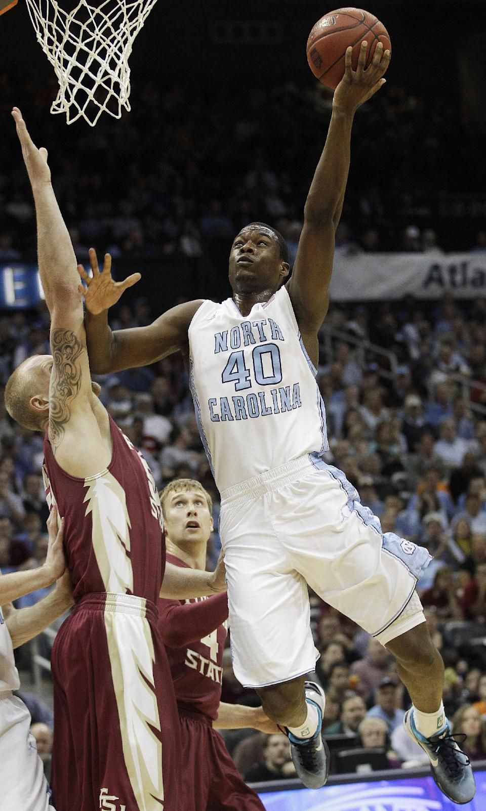 North Carolina Tar Heels forward Harrison Barnes (40) shoots over Florida State center Jon Kreft (50) during the first half of an NCAA college basketball game in the finals of the Atlantic Coast Conference tournament,  Sunday, March 11, 2012, in Atlanta. (AP Photo/Chuck Burton)