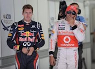 Second-placed Red Bull-Renault driver Sebastian Vettel of Germany (left) and third-placed McLaren-Mercedes&#39; Lewis Hamilton of Britain, seen after the qualifying session of the Formula One Korean Grand Prix in Yeongam on October 13. Mark Webber pipped his team-mate and reigning champion Vettel to the line to grab pole position for Sunday&#39;s GP, ensuring a front-row lock-out for Red Bull
