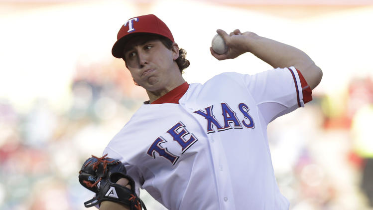 Texas Rangers starting pitcher Derek Holland throws during the fist inning of a baseball game against the Boston Red Sox on Friday, May 3, 2013, in Arlington, Texas. (AP Photo/LM Otero)